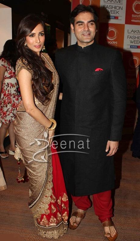 Malaika Arora Khan in beautiful gold and red designer saree. Celebrities at Vikram Phadnis Show 2013